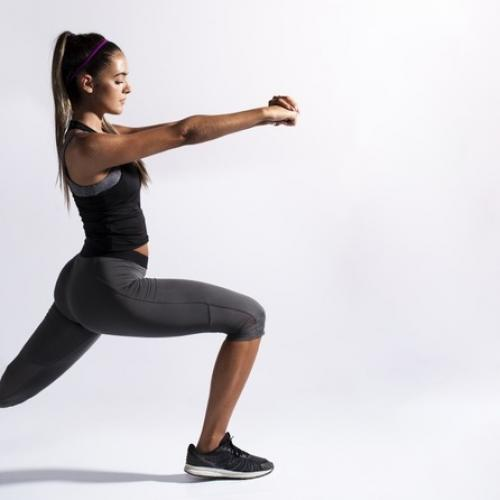 medium shot woman stretching with copy space 23 2148267333